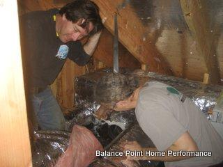 Dan and Gavin mucking about with some ducts in an attic!